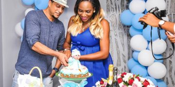 Aly and Sylvia cut the cake at her baby shower.