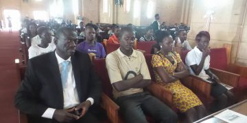 Besigye attending the service at Namirembe Cathedral.