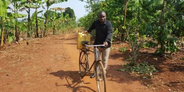Lukwago fetching water from the village well.