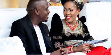 Pastor Geofrey Kayovu and Fyona. He promised that the official wedding day is soon.