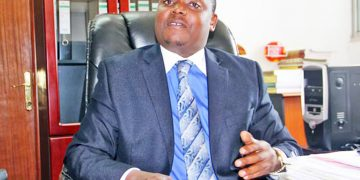 Minister Kibuule in his office.