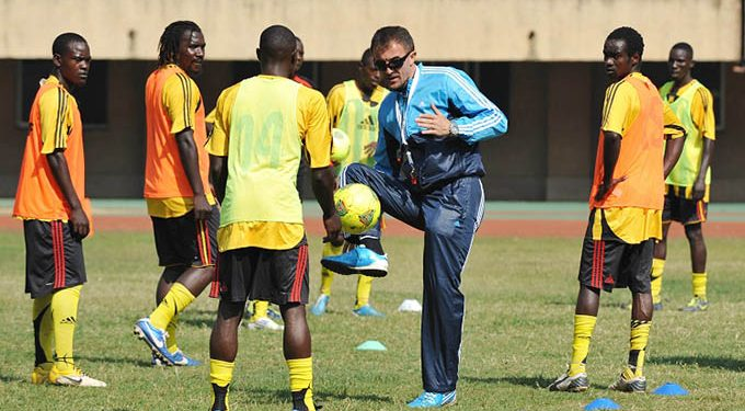 The Uganda National team, The Cranes coach Milutin Sredojevic demonstrates how it should be done during 2014 Chan Qualifier training at the Mandela Stadium, Namboole, Kampala on 08 June 2013 ©Ismail Kezaala/BackpagePix