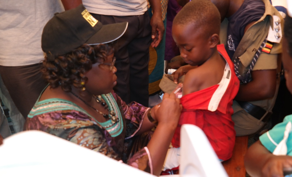 Hon. Dr. Moriku Joyce Odoki, Minister of State Primary Health Care immunizes a child during the launch of a free mass immunization campaign against Meningitis A (MEN A) in Omoro District on 17th January 2016. The campaign that will traverse 39 high risk districts in Uganda has been organized by the Ministry of Health in collaboration with World Health Organisation and partners.