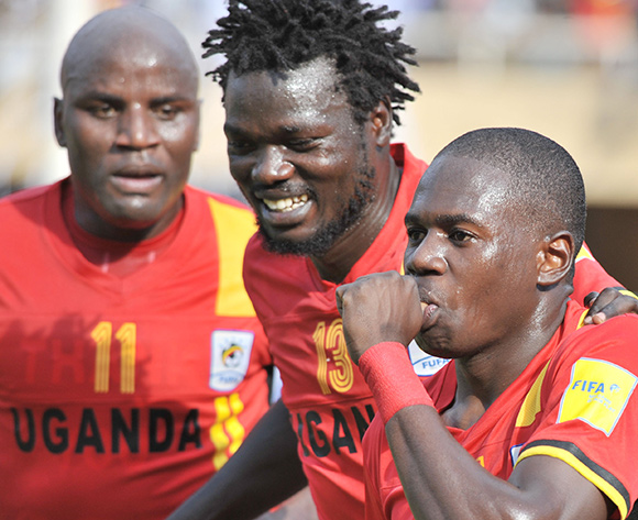 (L-R) Farouk Miya and Moses Oloya are joined by Geoffrey Massa of Uganda as they celebrate a score against Congo Brazzaville during the 2018 World Cup Qualifiers on 12 November 2016 at Mandela Stadium, Namboole. ©Ismail Kezaala/BackpagePix