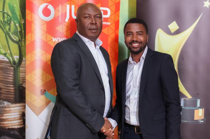 Vodafone Uganda CEO John Ndego and Reach A Hand's Humphrey Nabimanya.