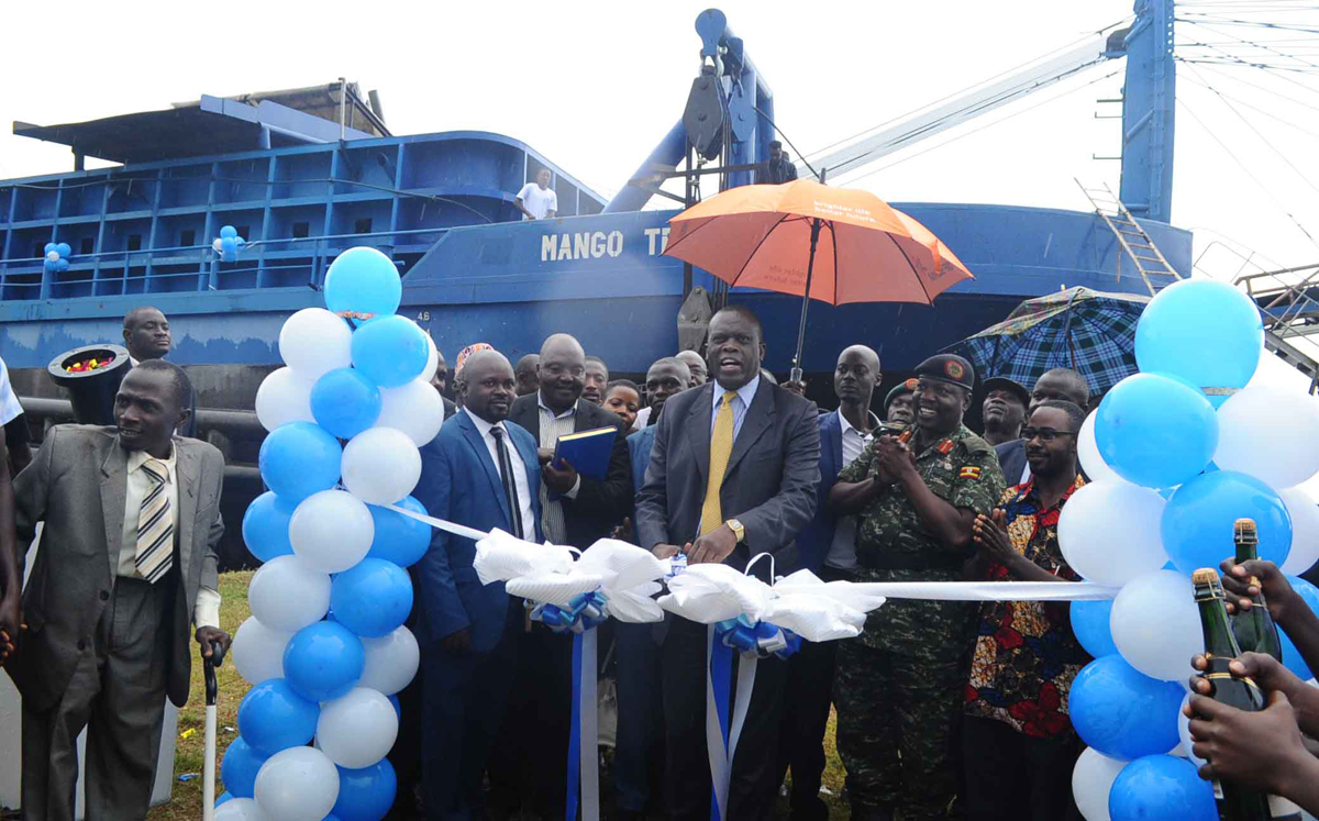 Minister Werikhe and OWC's Gen. Angina launch the vessel.