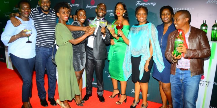 UBL's MD Alvin Mbugua with UBL's Brand Ambassadors at the launch of Tanqueray Gin last night. PHOTOS BY ASIIMWE VINCENT SMOKY/Matooke Republic.