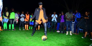 Cindy attempting a penalty shot last night at the Guinness Night Football in Mbale. PHOTOS BY ASIIMWE VINCENT SMOKY/Matooke Republic.