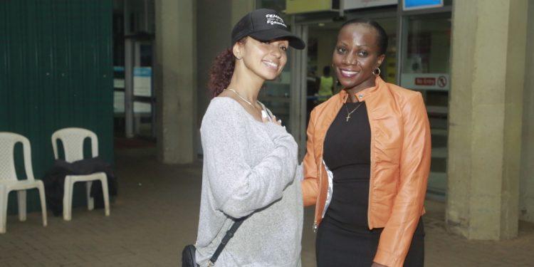 RnB sensation Mya with UBL's Head of Whisky Luxury Portfolio Annette Nakiyaga.