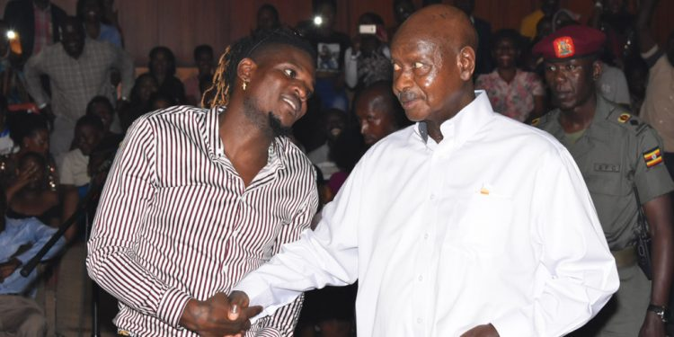 DJ Michael with President Museveni at an event last year.