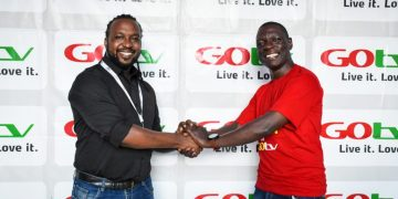 Dickson Zzizinga and MultiChoice Uganda's Head of Marketing Collin Asiimwe after the unveiling.