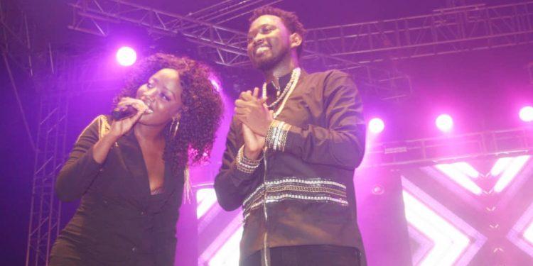 Levixone on stage with Lydia Jazmine. PHOTOS BY KASIGWA JOSEPH/Matooke Republic.