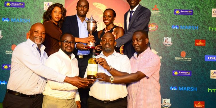 L-R: John Kato CEO Ekspresso, Centrics representative, Marvin Kagoro Vice Golf Captain Entebbe Club, Edwin Tumusiime Captain Entebbe Club. PHOTOS BY ASIIMWE VINCENT SMOKY/Matooke Republic.
