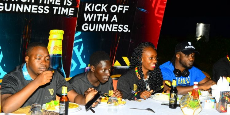 The winners enjoying their meal at Kabira Country Club last night, with Guinness Brand rep Cathy Twesigye and Bebe Cool. PHOTOS BY ASIIMWE VINCENT Smoky/Matooke Republic.