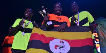 Uganda's Solomon Muleyi with teammates Ahmed Kassa and Andrew Asiimwe Elochu after their triumph.