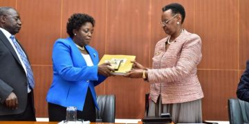Minister for Education and Sports Janet Museveni receiving UCE Exam results recently.