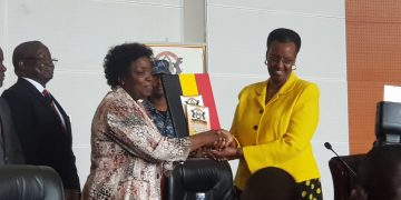 UNEB Chairperson Prof Mary Okwakol handing over 2019 Exam results to Janet Museveni, Minister of Education and Sports at the Office of the Prime Minister today.