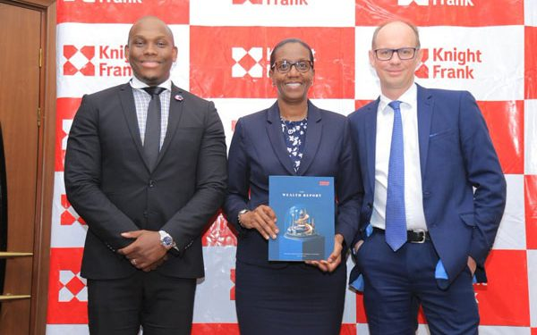 Vusi Thembekwayo with Knight Frank Uganda MD Judy Kyanda and Knight Frank Global editor of The Wealth Report Andrew Shirley at the launch of the report. COURTESY PHOTO.