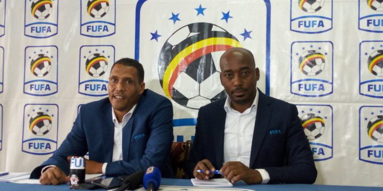 FUFA CEO Edgar Watson (L) during a press conference today.