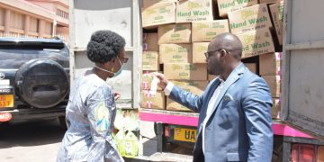 Health Minister DR Jane Ruth Aceng receiving the package from Movit Industries.