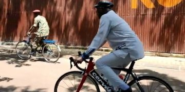 Security Minister Gen Elly Tumwine cycling to work this morning.