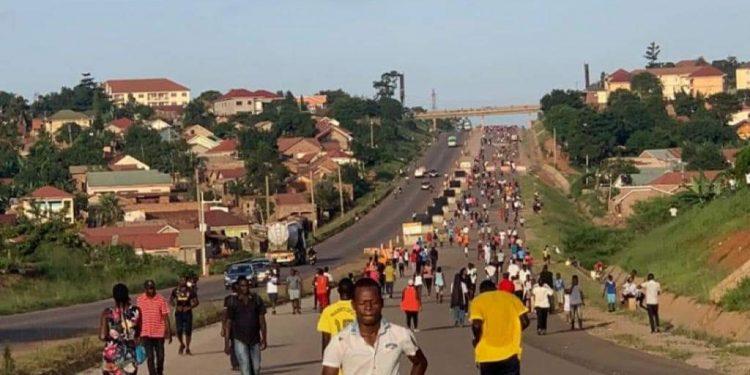 People jogging long the Kampala Northern Bypass. PHOTO BY KASOOBA WILLIM/Matooke Republic.