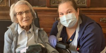 Connie Titchen, 106, with a nurse. COURTESY PHOTO.