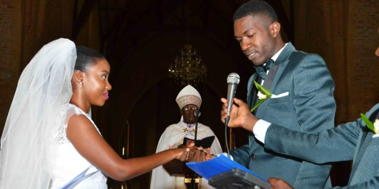 FOR RICH ND RICHER: The Enock and Josephine taking vows. COURTESY PHOTOS.