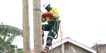 A Umeme field technician attends to a customer. The power distributor has maintained its technical teams who attend to faults in Kampala, Entebbe and Mukono areas, as well as entire upcountry faults teams, which are fully operational. The specialized teams that attend to big breakdowns and vital installations such as factories, healthcare facilities, security installations, and other vital facilities have also remained on standby.