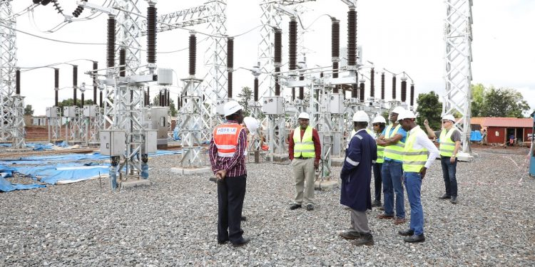 Umeme's Selestino Babungi (in red shirt) with one of Umeme's Board Directors at the new and bigger Lira Integration Substation in readiness for the upcoming 600 MW Karuma Hydro Power Station. As part of the UGX310 billion, Umeme has allocated significant resources to evacuate and distribute power from the in-construction Karuma and 16.5 MW Siti II Hydroelectric Power stations.