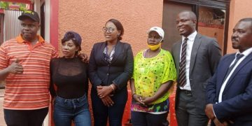 Events promoter Balaam Barugahara with Shanitah Namuyimbwa aka Bad Black and her lawyers.