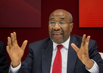 """Ruhakana Rugunda, Uganda's prime minister, speaks during an interview in New York, U.S., on Thursday, July 23, 2015. Compared with China, whose investments have grown 40-fold in the past 12 years, the U.S. is seen as """"lukewarm"""" in Africa, Rugunda said. Photographer: Michael Nagle/Bloomberg via Getty Images"""