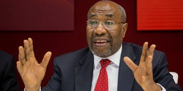"Ruhakana Rugunda, Uganda's prime minister, speaks during an interview in New York, U.S., on Thursday, July 23, 2015. Compared with China, whose investments have grown 40-fold in the past 12 years, the U.S. is seen as ""lukewarm"" in Africa, Rugunda said. Photographer: Michael Nagle/Bloomberg via Getty Images"