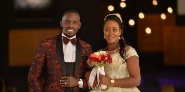 `NEWLY WEDS: Joel Ssenyonyi with his wife.