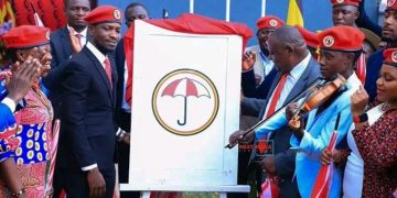 Bobi Wine unveiling the National Unity Platform logo at the People Power Offices.