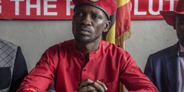 """Musician and opposition candidate Robert Kyagulanyi aka Bobi Wine during the press conference encouraging his """"people power"""" supporters to continue wearing their trademark red berets in Kampala. Uganda's military announced that red berets had been gazetted, and civilians in possession of them could be punished with up to five years in prison. (Photo by Sally Hayden / SOPA Images/Sipa USA)(Sipa via AP Images)"""