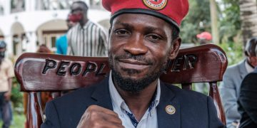 Ugandan opposition leader Robert Kyagulanyi, also known as Bobi Wine, poses for a photograph after his press conference at his home in Magere, Uganda, on January 26, 2021. - Ugandan soldiers have stood down their positions around the residence of opposition leader Bobi Wine, a day after a court ordered an end to the confinement of the presidential runner-up. He had been under de-facto house arrest at his home outside the capital, Kampala, since he returned from voting on January 14, 2021. For 11 days heavily armed soldiers and police officers surrounding the property had prevented members of Wine's household, including his wife, Barbie, from leaving their compound and denied access to visitors. (Photo by SUMY SADURNI / AFP)