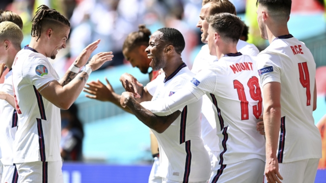 England's Raheem Sterling, center, celebrates with his teammates after scoring his side's opening goal during the Euro 2020 soccer championship group D match between England and Croatia at Wembley stadium in London, Sunday, June 13, 2021. (Glyn Kirk/Pool Photo via AP)